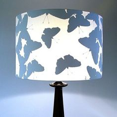 DIY ~ a contemporary table lamp SILHOUETTE BUTTERFLY (WHITE) by adhering paper butterfly shapes in the same color as the lamp to the interior.