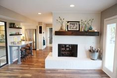 Love this asymmetrical fireplace!!