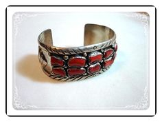 Hey, I found this really awesome Etsy listing at https://www.etsy.com/listing/95541671/coral-sterling-cuff-silver-wide-cuff-by