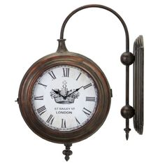 Antique brass finish Winston 2-sided train clock could have kept time at Charing Cross. Unique 2-sided design allows train clock to be installed on either side of a traditional living room, den or game room. Roman numerals on crown dial.