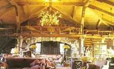 More Adirondack Style Fireplaces ... our living room has a fireplace with rock up to the ceiling, would like to use this as inspiration for a wood mantel with supports...