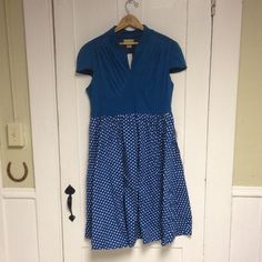Vintage Style Dress Lindy Bop vintage style dress. Tried on once over clothes, did not work for me. Will include original packaging and belt. Still has tags. Very comfortable fabric and well made! U.K. Size 16, us size 14. Lindy Bop Dresses Midi