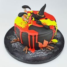 Halloween Cauldron Drip Cake. To view the tutorial, please visit http://www.craftcompany.co.uk/halloween-cauldron-drip-cake.html