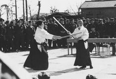 Here are three unpublished photos from the personal collection of Morihiro Saito taken c. 1955. Morihei is aged 71 years and Saito Sensei is about 27 years old. Although the exact location is unknown, it appears as though the event is taking place at a Self-Defense Force facility due to the presence of uniformed observers.