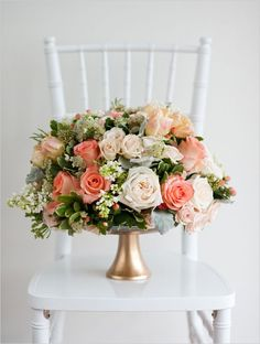 Beautiful peach and coral floral arrangement <3 #peach #coral #wedding
