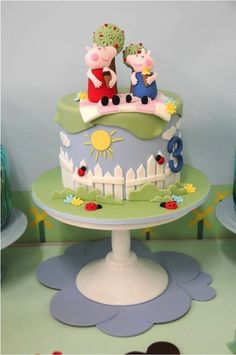 A Peppa Pig party with paper mache food, adorable cake toppers, mini rain boot and umbrella topped cupcakes, grassy place mats, + crown kid's chair backs Tortas Peppa Pig, Bolo Da Peppa Pig, Peppa Pig Birthday Cake, Aniversario Peppa Pig, Gateaux Cake, Pig Party, Party Fun, Novelty Cakes, Cute Cakes