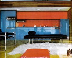 A Wassily chair and a Mies daybed pop against blue enamel and orange.