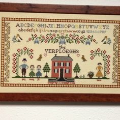 Counted cross stitched family sampler