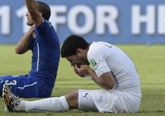 FIFA bans Uruguay\'s Luis Suarez for 9 games and 4 months for biting opponent at World Cup