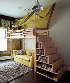 Love this loft bed and bookshelf steps. Awesome use of space.