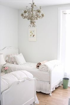 Shabby chic bedroom with flower chandelier