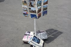 Postcard stand by the beach at Ain Diab in Casablanca. Morocco's tourism industry has played a large role in national development and ranks as the second largest source of income for the nation after the phosphate industry.