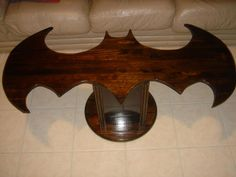 Batman Coffee Table - I don't think I would ever have something like this in my home. Can you imagine hitting your shins on one of these corners? Ouch!!!