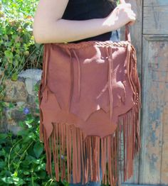 This purse is ready to ship!!!  I named this one CAT WHISKERS  Shown here is my beautiful HOBO bag in TOBACCO deerskin!!!  Measurements: 10 tall x 12