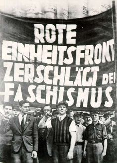 "Communist Party Anti-Nazi Demonstration The banner reads, in English: ""Red United Front Smashes Fascism!"""