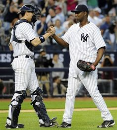 GAME 145: Saturday, Sept. 15, 2012 - New York Yankees catcher Chris Stewart congratulates relief pitcher Rafael Soriano after the Yankees defeated the Tampa Bay Rays 5-3 in a baseball game at Yankee Stadium in New York.