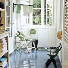 This enclosed porch multitasks as a catchall for sandy flip-flops and damp towels. Folding chairs offer comfy spots to put on sandals or pack a tote before heading outside.