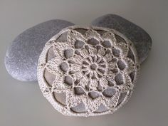 I've fought the urge for some time.  It's time I give into the useless, but somehow lovely, Crocheted Lace Covered Stones