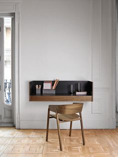 Designer Mario Ruiz combines natural and stained woods with polished and anodized aluminum in a new collection of sideboards for Punt called Stockholm.