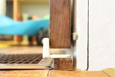 """BARN DOOR STOPS To prevent the door from swinging out into the room, he mounted some little rubber """"stops"""" to a couple of chunks of wood that are screwed down into the floor… There's one on the opposite side of the door opening too… Diy Sliding Barn Door, Sliding Closet Doors, Barn Doors, Door Frame Molding, Small Office Furniture, Wood Screws, Barn Door Hardware, Wall, Master Bedroom"""
