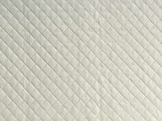 Off White Quilted Leatherette Fabric