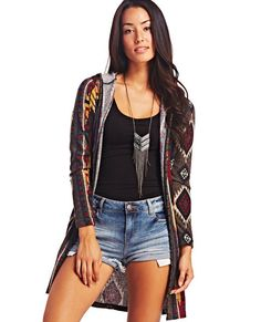 "<p>Go long in this cardigan duster sweater that has a stylishly long length that's super cozy and features a multicolored southwestern-inspired print, long sleeves, open front and hood.</p>  <p>Model is 5'9"" and wears size small.</p>  <ul> 	<li>100% Polyester</li> 	<li>Machine Wash</li> 	<li>Imported</li> </ul>"