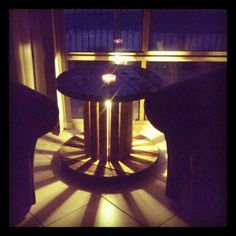 Recycled electrical reel turned coffee table with lamp inside, looks awesome at night
