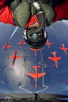 What a shot! This is the UK's Royal Air Force, the Red Arrows aerobatics display team.  Celebrating their 50th anniversary.