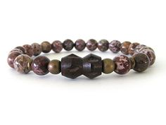 Handsome men's beaded stretch bracelet with 8mm Tiger jasper beads, antique brass accent beads and a carved wood bicone focal bead.