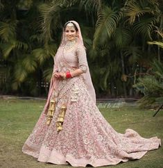 A pink lehenga is a dream outfit in every bride's wardrobe! Especially if that bride has a 'pink fever'! Check out some stunning lehengas in pink for major inspo! Golden Bridal Lehenga, Pink Bridal Lehenga, Pink Lehenga, Indian Bridal Lehenga, Indian Bridal Outfits, Indian Bridal Fashion, Lehenga Choli, Saree, Wedding Lehenga Designs