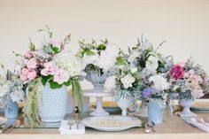 floral arrangements with hobnail milk glass by VintageWhitesWeddings.com // photo by AliciaBrownPhotography.com