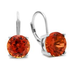 These earrings feature 2 round created padparadscha sapphire gemstones totaling at 5 1/2 carats. Each gemstone measures 8mm. Earrings are crafted in sterling silver and have secure leverbacks. Earring