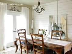 cedar plank walls, gorgeous dining table and chairs, chandy, french doors