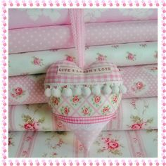 Gorgeous pink patchwork & pompom heart hangers made with Cath Kidston fabric available at: www.thevintagequilt.co.uk