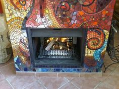 Mosaic Fireplace - buy inexpensive indoor FP and make own Mantel to look built-in and BEAUTIFUL!