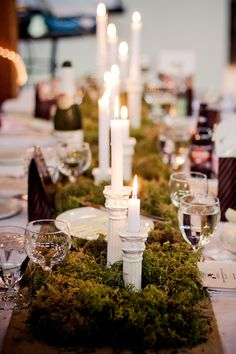 Moss with white candlesticks and tapers on burlap runner - rustic & elegant