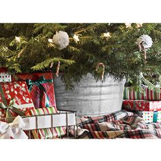 """A Homespun Tree Stand - Hide an unsightly tree stand in a timeless galvanized tub. """"Not only does it look adorably rustic,"""" Thompson says, """"but the tub can hold enough water to nourish your tree for days at a time."""" (love this idea! Christmas Decor Diy Cheap, Homemade Christmas Crafts, Cute Christmas Tree, Christmas Craft Projects, Noel Christmas, Country Christmas, Holiday Crafts, Christmas Decorations, Christmas Ideas"""