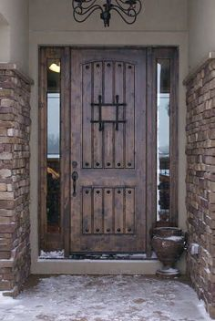 A dark Mahogany door with iron details that add a luxurious feel to your entry way.