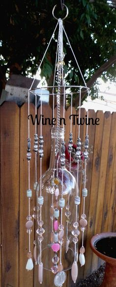 Wine Bottle Wind Chime Recycled Wine Bottle Wind Chime by WinenTwine on EtsyRecycled Wine Bottle Wind Chime by WinenTwine on Etsy Wine Bottle Chimes, Wine Bottle Corks, Glass Bottle Crafts, Bottle Candles, Carillons Diy, Recycled Wine Bottles, Diy Wind Chimes, Creation Deco, Glass Art