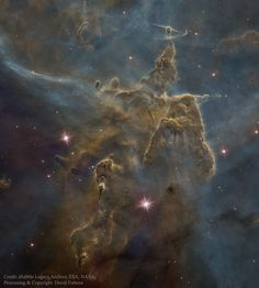 Mystic Mountain Dust Pillars  Image Credit: Hubble Legacy Archive, NASA, ESA; Processing & Copyright: David Forteza