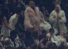 Party time: Lamar stayed seated while Khloe and her sisters stood up to dance along to one of the tracks
