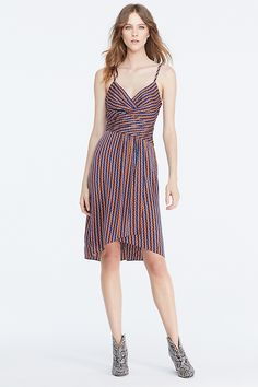 The DVF Saige mixes all of our favorite things for Pre-Fall. A menswear-inspired print brings an unexpected feel to this faux-wrap slip dress with twist-front details. With invisible side zip.