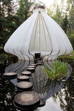 Floating pond pod with stepping stones.