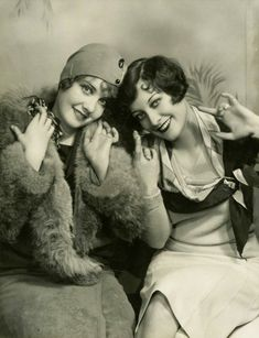Anita Page and Joan Crawford in a 1928 promotional picture by Ruth Harriet Louise