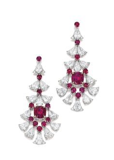Pair of Ruby and Diamond Pendent Earrings. Of chandelier design, each set with a cushion-shaped ruby weighing 2.15 and 2.08 carats respectively, embellished with circular-cut rubies, pear-shaped and brilliant-cut diamonds, post and butterfly fittings.