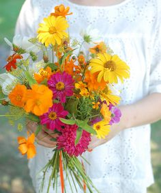 This would be the most realistic bouquet for the bridesmaids, given the flowers I think we have, and it would be lovely against their dresses. Cutting garden bouquet zinnia