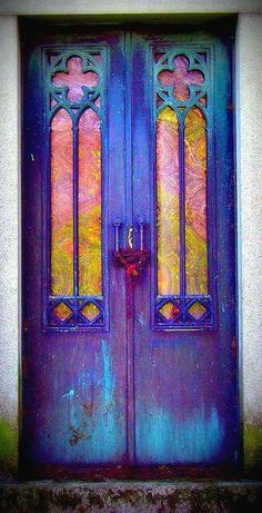 This door certainly gave someone a chance to be creative and colorful... I love it!!