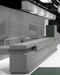 Furniture executed in EQUITONE facade materials at Eternit Bau Munich booth. All desks, seats, lamps made of grey through coloured EQUITONE materials. #design #architecture #furniture #material www.equitone.com