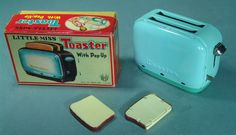 Wow! This old stock tin toaster measures about 6 inches wide and is in unplayed with condition. Drop in the tin (!) toast slices, press the lever to lower them, and push the switch to eject them when