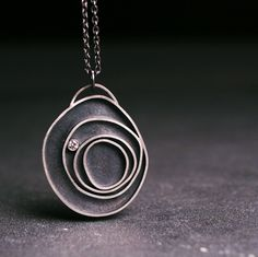 Diamond and sterling silver pendant Orbit by Ann Hartley